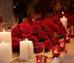 Red roses centerpiece with white candles - can still see people across from you :)