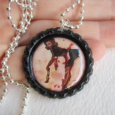 Guts For Garters BottleCap Necklace by TheInklingGirl on Etsy, $10.00