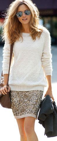 Cream cashmere sweater and a gold sequin skirt.