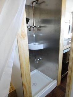 The shower has a bathroom sink inside it.