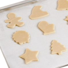 Many bakers like to roll out dough between 2 parchment sheets to prevent dough from sticking to the rolling pin. After rolling dough between parchment, lift off the top sheet and cut cookies. Remove dough around cut shapes, then bake cookies.