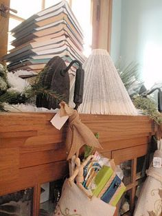 vintage irons used as stocking holders! Isn't that adorable? I need to put those on my list for my next antique shopping trip! Note, the books in the back stacked in the shape of a Christmas tree, super cute too!