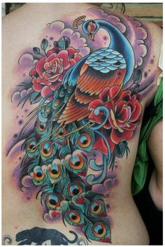 Oldschool traditional color back piece peacock tattoo http://blog.tattoodo.com/2014/04/40-enticing-peacock-tattoos/