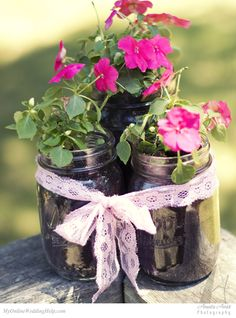 Plant flowers in Kerr jars to use as both centerpieces and favors