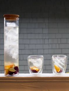 A white sangria with fresh cherries, peaches, and limes.
