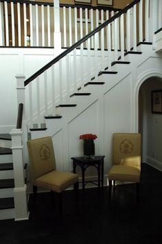 black stair, white railing