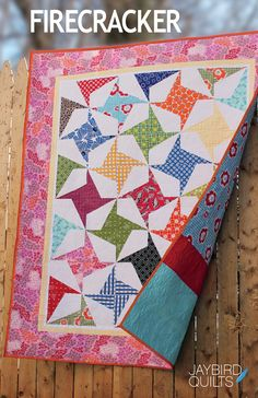 Firecracker Quilt Pattern designed by Julie Herman of Jaybird Quilts. Mix bright prints with a contrasting background for an explosive quilt!