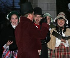 """The event began with Jane Froman carolers in festive Dickensian costumes singing """"Deck the Halls,"""" followed by a speech from Columbia College President Gerald Brouder.      Jane Froman singers perform """"Deck the Halls"""" during Columbia College's annual holiday lighting ceremony.  Students, faculty and members of the community gathered for the event and were invited to mingle afterward while food was served and the Jane Froman carolers continued singing."""