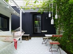 private patio with hammock and pergola