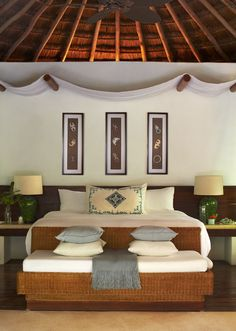 Whicker bed frame and draped tapestry creates the exotic vibe of the jungle villa at Viceroy Riviera Maya.