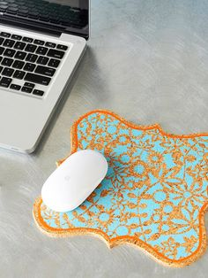 This is really cute --- a mousepad made from corkboard...