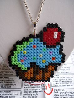 Hama Bead Blue Cupcake Necklace. £3.00, via Etsy.