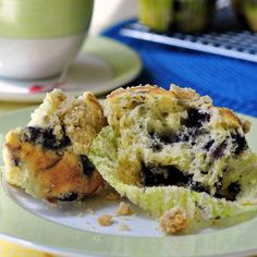 Blueberry Lemon Crumble Muffins - moist blueberry muffins with the zing of lemon zest added and topped with a buttery oatmeal crumble. The perfect addition to a sunny morning brunch.