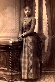 Young woman, 1880s. Love the use of plaid!