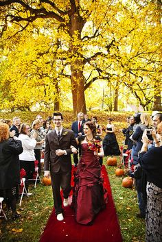 Gorgeous autumn wedding! Love the leaf color with her deep red dress