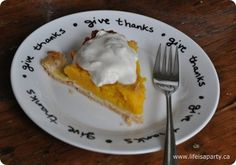 "Use a glass paint marker to turn a plain white plate into a Crate & Barrel inspired ""Give Thanks"" plate for Thanksgiving."