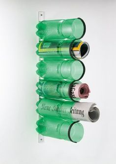 PET Bottles into a Magazine Rack.Click on image to see more. craft, plastic bottles, soda bottles, recycled bottles, pop bottles, magazine racks, magazine storage, old bottles, water bottles