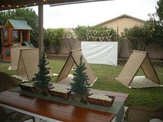 Camping Party - tents set up in the backyard for a sleepover or play during an afternoon party