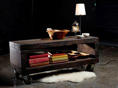 Combine reclaimed wood and casters to create a rugged coffee table with a touch of industrial chic — a beautiful centerpiece for your living room.