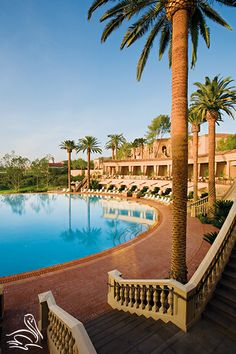 Sitting at the beautiful Coliseum Pool and magnificent grounds at The Resort at Pelican Hill, Newport Beach, CA | www.pelicanhill.com