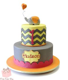 Hudson's 1st Birthday Cake.  This cake was inspired by the invitation - orange, yellow, pink and gray were party colors and the party was elephant themed!    We received this wonderful facebook comment from our longtime customer Kat after the event:  Thank you once again for an amazing and delicious cake! We are always so happy with your creations each year. Now we get to work with you for both kids' birthdays. Let the fun creativity continue!
