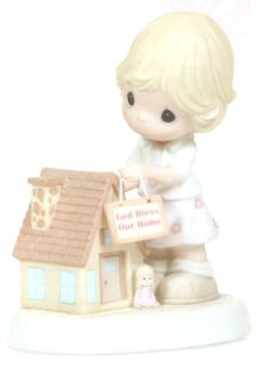 Precious Moments God Bless Our Home May our house be filled with love, laughter and special memories. A home where God smiles upon us everyday. This is a perfect gift for a housewarming. Figurine is made of porcelain. $45.00 #PreciousMoments