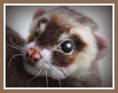 Needle felted ferret by Amanda Adebisi of Fit to be loved. Click for more photos of beautiful long fur. Curled up and asking for a cuddle