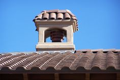Mission style chimney crown in stucco ready / spanish tile ready format from Chimney King. UL listed and labeled for use with HHT fireplace pipes in this case.