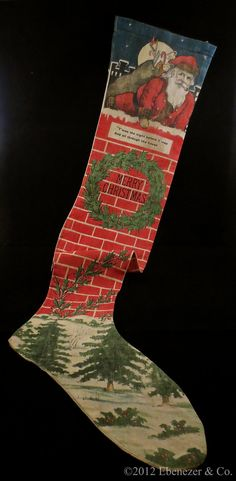 Antique linen/cotton printed Christmas stocking featuring Santa Claus in the chimney.