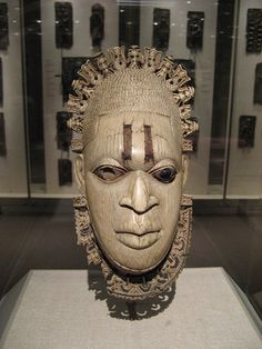 """Ivory Mask from Benin, Nigeria. """"This African mask is carved out of ivory for the """"Oba"""" (king) of Benin, and is believed to be dated from the 16th Century. This mask was actually not worn over the face, but rather as a pendant, either around the neck like a necklace or hanging from the king's hip, like a belt"""" (Artsology). See additional resources for teaching about/with this mask at: http://www.artsology.com/benin_mask.php"""