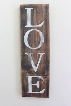 Take an old wood plank, some dark leftover stain, DIY letter stencils, paint white et voilà .... easy, beautiful wall art!