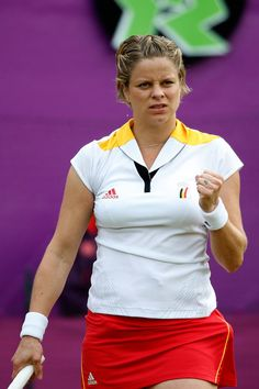 London 2012 - Kim Clijsters of Belgium celebrates a point during her 6-3 6-3 Women's Singles Tennis second round match against Carla Suarez Navarro at Wimbledon.  2012 Getty Images
