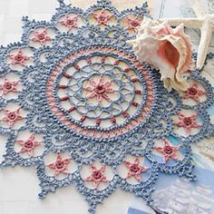crochet pattern with 5 point stars, blue and pink crochet pattern doily, kathryn white, doily patterns, croche mandalas, star, crochet patterns for home, doili pattern, crochet doilies, knitted doilies