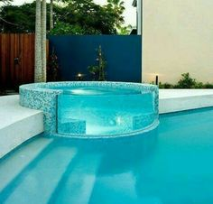 Cool pool and glass hot tub