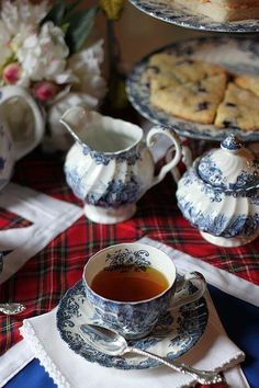 Red plaid linens with blue and white china