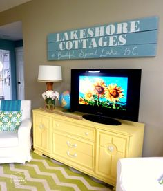 Colorful Lake House tour filled with tons of great DIY ideas!  Love that sign!