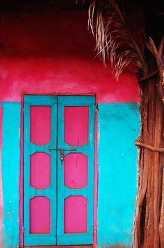 love the hot pink and blue doors