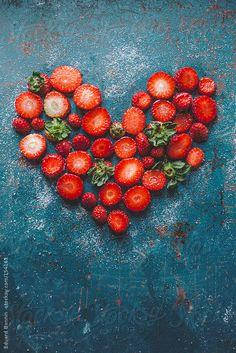 Strawberry heart on blue background by Eduard Bonnin