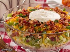 Seven Layer Potato Salad - Homemade deli salads are wonderful for your summer bring-along. This salad will easily feed a crowd and is perfect for an outdoor picnic.