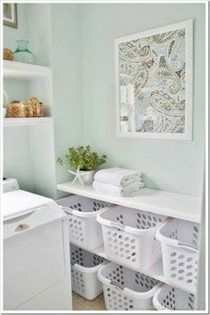 Love the colors in this laundry room