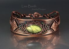Here is a hand woven piece with a bright green Labradorite as the centerpiece.  This will be in the book that I am writing right now. --Lisa Barth
