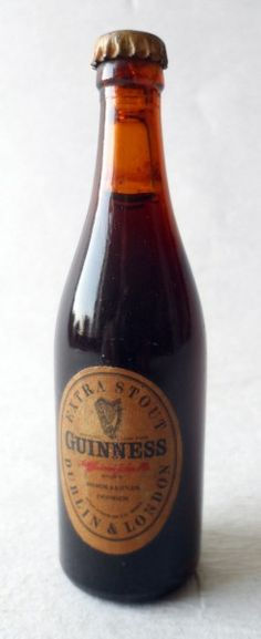 Vintage Bar Ware Advertising Miniature Mini Extra Stout Guinness Souvenir Glass Bottle Circa 1950s Full Crown Cork Guiness Guinnes #FollowVintage