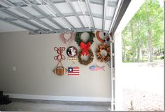Wreath Storage in the Garage.  Genius!! (I'll add a trash bag over each to keep dust-free)