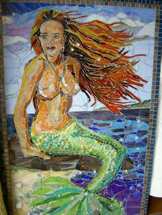 """The Mermaid Morrigan  31 1/4 x 48 """"  Stained glass, glass beads mirror bits on Hardiboard  38 lbs"""