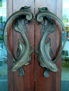 Art nouveau door handles at the Roxy Cinema in Miramar, Wellington, New Zealand.