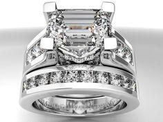 Modern Horizontal Emerald Cut diamond Engagement ring.