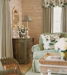 Whitewashed pine walls with soft greens & painted furniture.