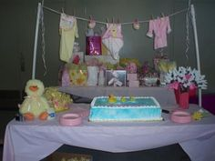 Baby shower on pinterest baby shower decorations baby for Baby clothesline decoration