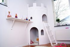 This cute DIY indoor playhouse has two levels and is styled like a castle tower! So fun for a little knight or princess to play in.