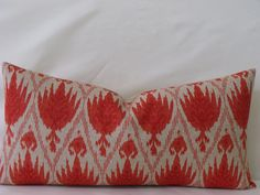 "Decorative Designer Ikat Lumbar Pillow Cover - 12"" x 22"" - Coral on a Natural Background. $40.00, via Etsy."
